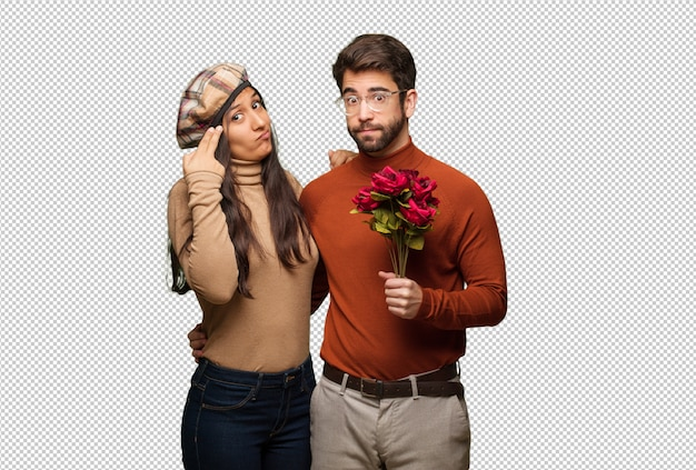 Young couple in valentines day doing a suicide gesture
