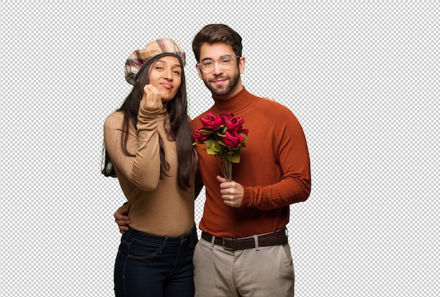 Young couple in valentines day doing a typical italian gesture