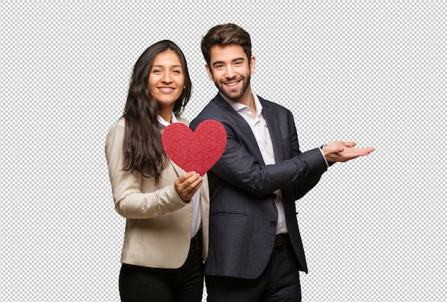 Young couple in valentines day holding something with hand