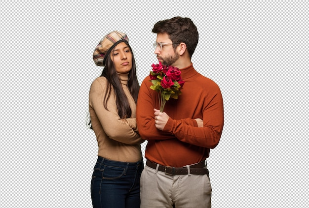 Young couple in valentines day looking straight ahead