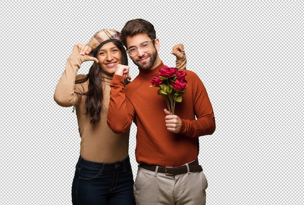 Young couple in valentines day pointing fingers, example to follow