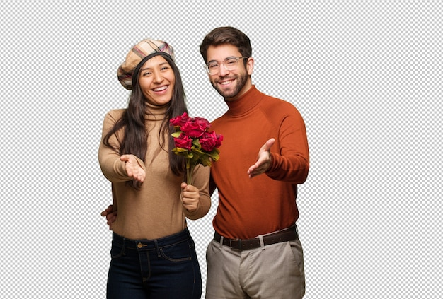 Young couple in valentines day reaching out to greet someone