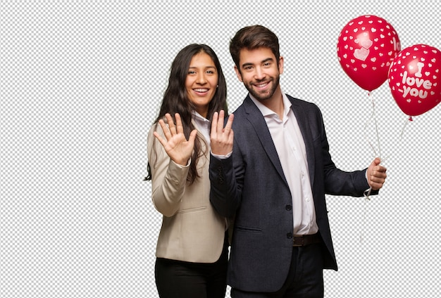 Young couple in valentines day showing number eight