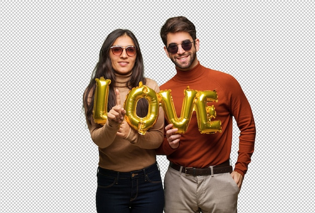 Young couple in valentines day showing number one