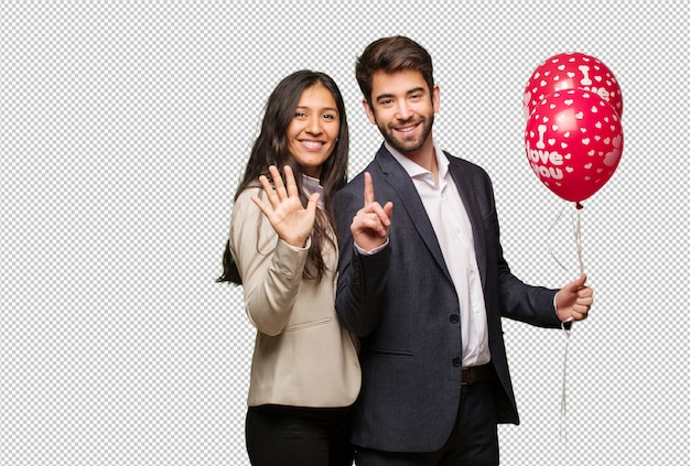 Young couple in valentines day showing number six