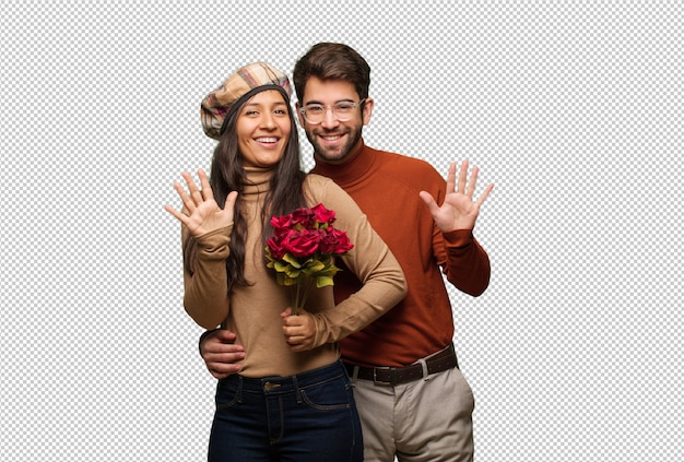 Young couple in valentines day showing number ten