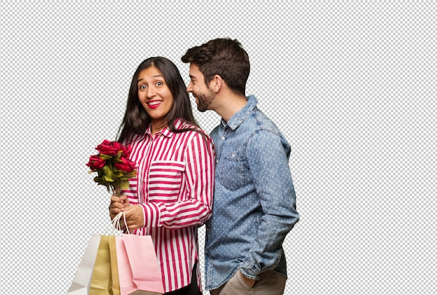 Young couple in valentines day on the side looking to front