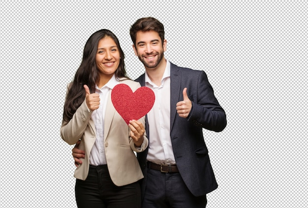 Young couple in valentines day smiling and raising thumb up
