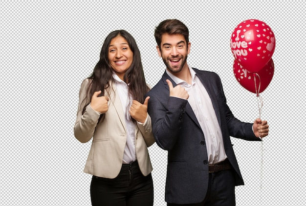 Young couple in valentines day surprised, feels successful and prosperous