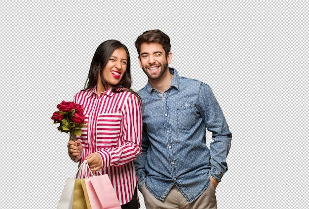 Young couple in valentines day winking, funny, friendly and carefree gesture