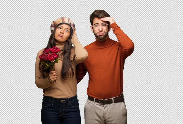 Young couple in valentines day worried and overwhelmed