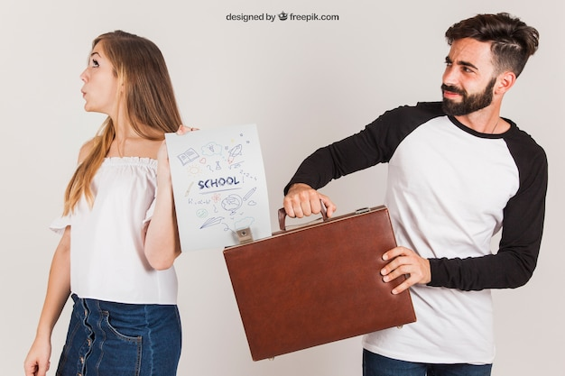 Young couple with briefcase and paper