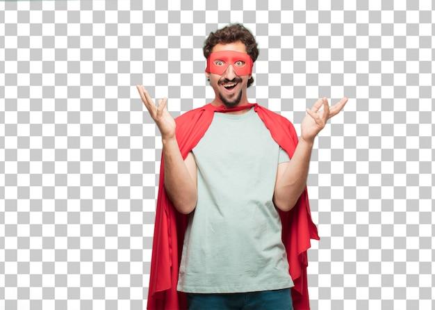 Молодой сумасшедший супер герой человек поражен или шокирован выражением