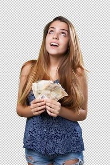 紙幣を保持している若いかわいい女性