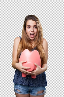Young cute woman with a big piggy bank
