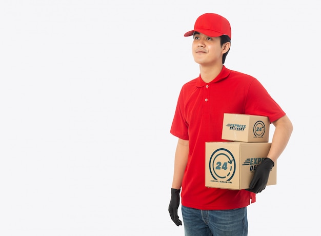 Young delivery man holding paper cardboard box mockup
