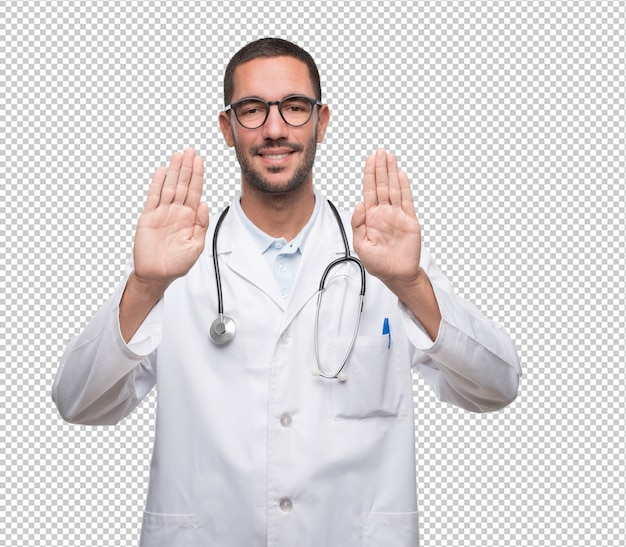 Young doctor doing a gesture of stop with his hands