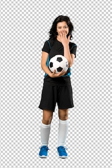 Young football player woman with surprise facial expression