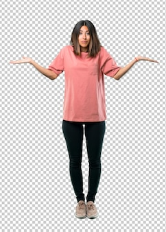 Young girl with pink shirt having doubts and with confuse face expression