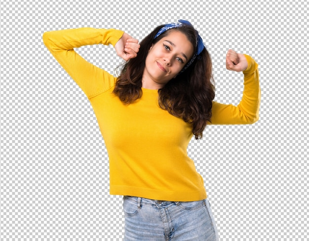 Young girl with yellow sweater and blue bandana on her head enjoy dancing