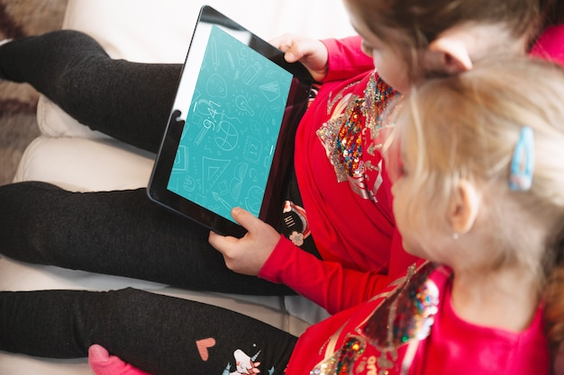 Young girls using tablet
