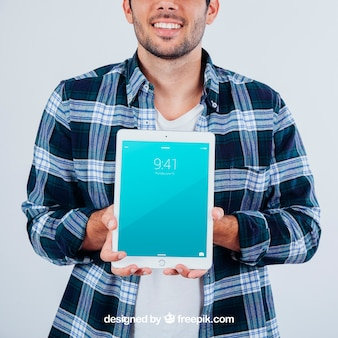Young guy holding tablet's mock up