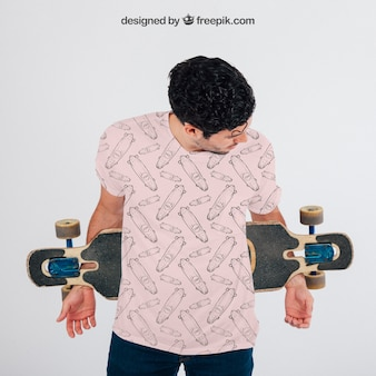 Young guy with skateboard and t-shirt's mock up