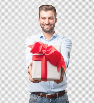 Young handsome man holding present box