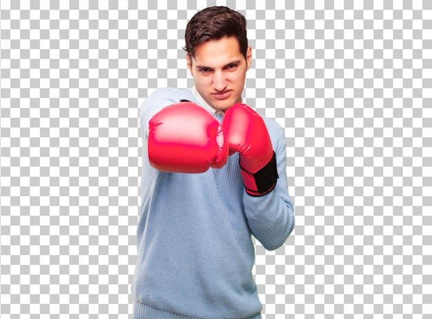 Young handsome tanned man wearing boxing gloves
