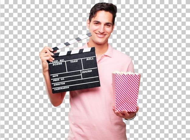 Молодой загорелый красавец с кинохлопушкой
