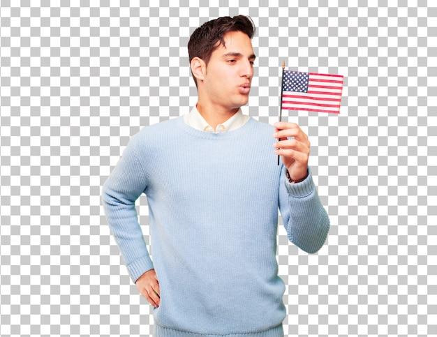 Молодой загорелый красавец с флагом сша