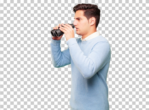 Young handsome tanned man with binoculars