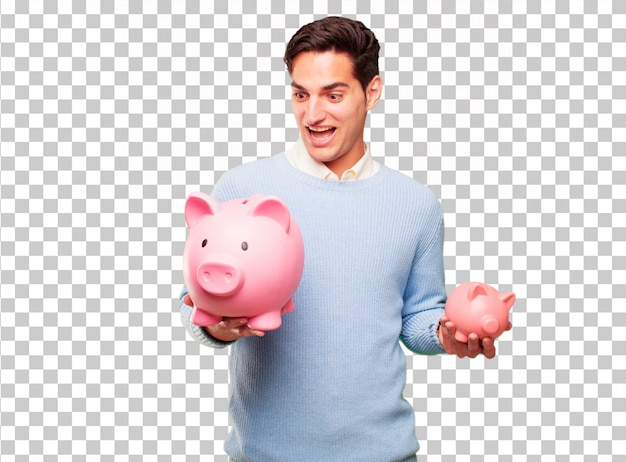 Young handsome tanned man with a piggy bank