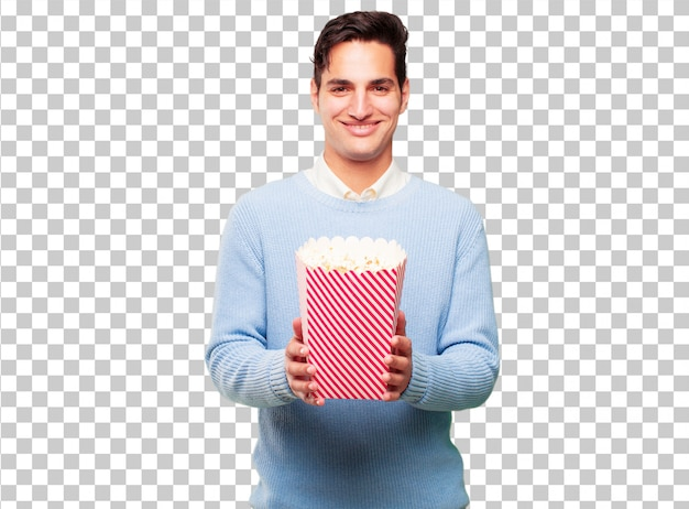 Young handsome tanned man with a pop corn bucket