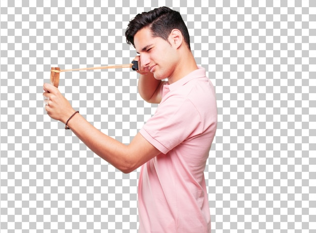 Young handsome tanned man with a slingshot