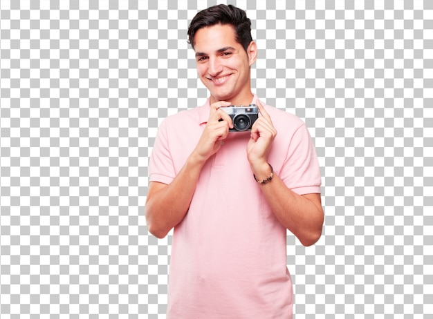 Young handsome tanned man with a vintage camera