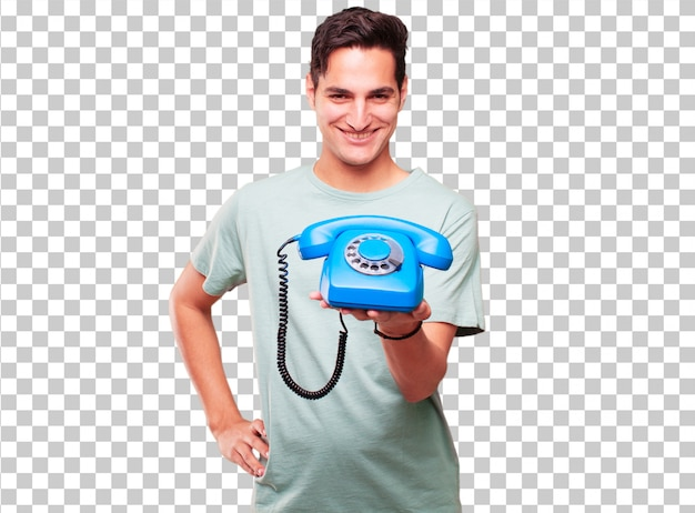 Young handsome tanned man with a vintage telephone