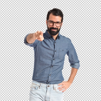 Young hipster man pointing to the front