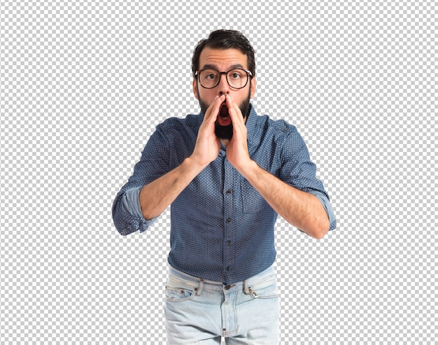 Young hipster man shouting over white background
