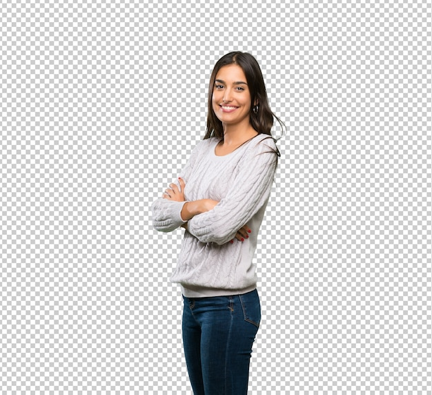 Young hispanic brunette woman with arms crossed and looking forward