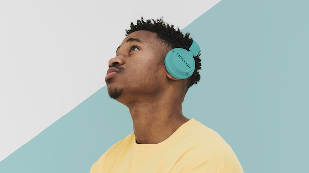 Young male portrait with headphones mockup