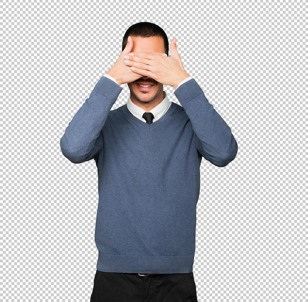 Young man covering his eyes with his hands