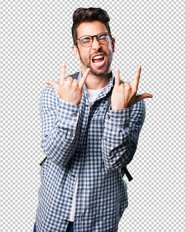 Young man doing rock gesture