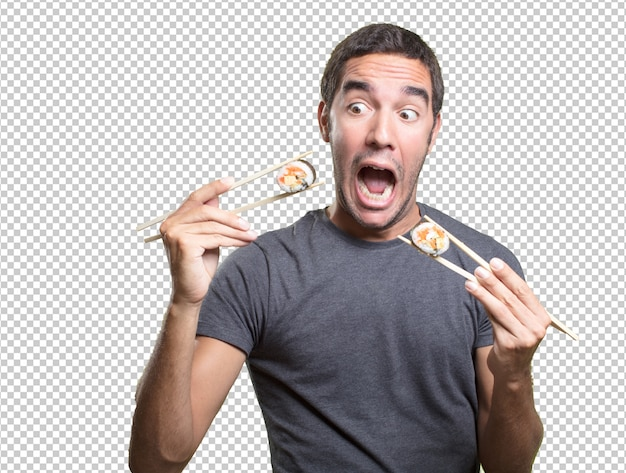 Young man eating sushi