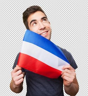 깃발을 들고 젊은 남자