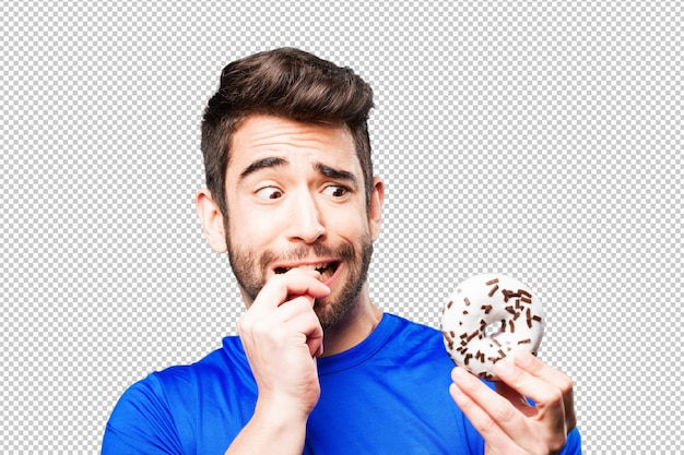 Young man holding doughnut