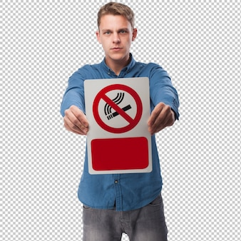 Young man holding a prohibited smoke are sign