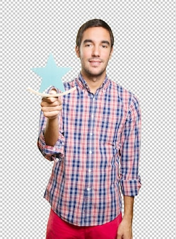 Young man in christmas holding a star