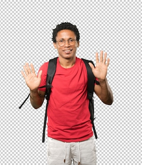 Young man making a number ten gesture