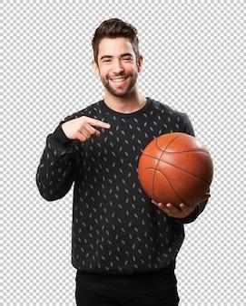 Young man playing basket